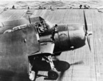 'Round Trip' Battle-Damaged TBM Avenger Back On Board USS Ticonderoga (CV 14)piloted by Ensign C.V. Higman